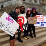 women with signs at U.S. capitol